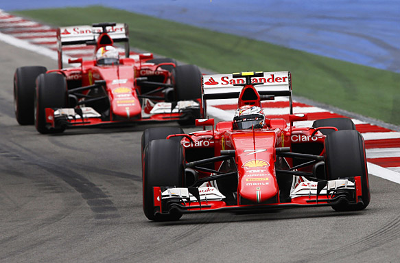 Sochi Autodrom, Sochi, Russia. Sunday 11 October 2015. Kimi Raikkonen, Ferrari SF-15T, leads Sebastian Vettel, Ferrari SF-15T. World Copyright: Charles Coates/LAT Photographic ref: Digital Image _J5R4854