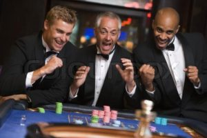 1236192-730952-group-of-men-celebrating-win-at-roulette-table-in-casino