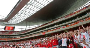 "London, UNITED KINGDOM: Spectators do the Mexican wave during a pre season ""Dennis Bergkamp"" testimonial match between Arsenal and Ajax at Emirates stadium in north London, 22 July 2006. The match played in honour of Arsenal's Dutch player Dennis Bergkamp who has served the club for 11 years and will retire after the game is the first match played at the club's new stadium. AFP PHOTO / ODD ANDERSEN (Photo credit should read ODD ANDERSEN/AFP/Getty Images)"