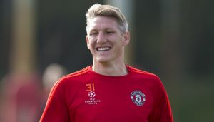 Manchester United's Bastian Schweinsteiger smiles as he trains with teammates at Carrington training ground in Manchester, Tuesday, Sept. 29, 2015. Manchester United will play VFL Wolfsberg in a Champions League group B soccer match on Wednesday. (AP Photo/Jon Super)