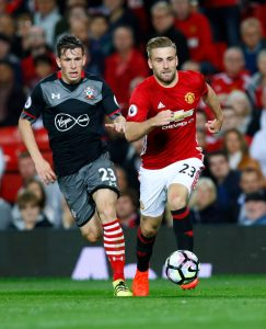 "Football Soccer Britain - Manchester United v Southampton - Premier League - Old Trafford - 19/8/16 Manchester United's Luke Shaw in action with Southampton's Pierre-Emile Hojbjerg Action Images via Reuters / Jason Cairnduff Livepic EDITORIAL USE ONLY. No use with unauthorized audio, video, data, fixture lists, club/league logos or ""live"" services. Online in-match use limited to 45 images, no video emulation. No use in betting, games or single club/league/player publications. Please contact your account representative for further details."