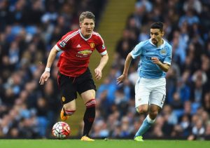 MANCHESTER, ENGLAND - MARCH 20: Bastian Schweinsteiger of Manchester United is chased by Jesus Navas of Manchester City during the Barclays Premier League match between Manchester City and Manchester United at Etihad Stadium on March 20, 2016 in Manchester, United Kingdom. (Photo by Laurence Griffiths/Getty Images)