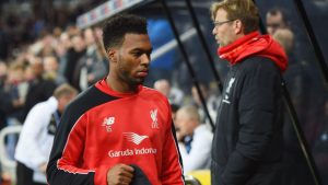 NEWCASTLE UPON TYNE, ENGLAND - DECEMBER 06: Substitute Daniel Sturridge of Liverpool walks to the bench past Jurgen Klopp manager of Liverpool prior to the Barclays Premier League match between Newcastle United and Liverpool at St James' Park on December 6, 2015 in Newcastle upon Tyne, England (Photo by Michael Regan/Getty Images)