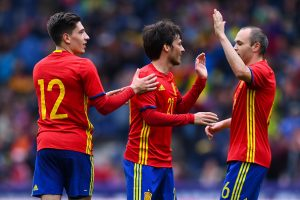 SALZBURG, AUSTRIA - JUNE 01: David Silva (C) of Spain celebrates with his teammates Hector Bellerin and Andres Iniesta after scoring the opening goal during an international friendly match between Spain and Korea at the Red Bull Arena stadium on June 1, 2016 in Salzburg, Austria. (Photo by David Ramos/Getty Images)