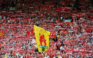 UEFA Champions League Semi Final: Liverpool v Chelsea...LIVERPOOL, UNITED KINGDOM - MAY 01: Liverpool fans in the KOP End cheer prior to the UEFA Champions League semi final second leg match between Liverpool and Chelsea at Anfield on May 1, 2007 in Liverpool, England. (Photo by Mark Thompson/Getty Images)