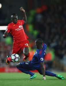 LIVERPOOL, ENGLAND - OCTOBER 17: Sadio Mane of Liverpool skips past Eric Bailly of Manchester United during the Premier League match between Liverpool and Manchester United at Anfield on October 17, 2016 in Liverpool, England. (Photo by Clive Brunskill/Getty Images)