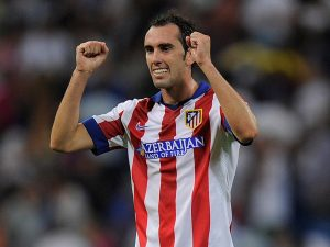 MADRID, SPAIN - SEPTEMBER 13:  Diego Godin of Atletico de Madrid celebrates after Atletico beat Real Madrid 2-1 in the La Liga match between Real Madrid and Atletico de Madrid at Estadio Santiago Bernabeu on September 13, 2014 in Madrid, Spain.  (Photo by Denis Doyle/Getty Images)